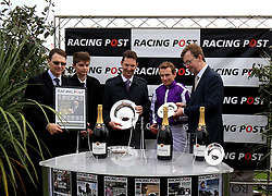 Trainer Aidan O'Brien (Left) and jockey Ryan Moore (Second right) after winning the Racing Post Trophy Stakes during Racing Post Trophy day at Doncaster Racecourse. PRESS ASSOCIATION Photo. Picture date: Saturday October 28, 2017. See PA story RACING Doncaster. Photo credit should read: Clint Hughes/PA Wire