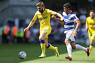 Stuart Dallas of Leeds United is intercepted by Massimo Luongo of QPR. Skybet EFL championship match, Queens Park Rangers v Leeds United at Loftus Road Stadium in London on Sunday 7th August 2016.<br /> pic by John Patrick Fletcher, Andrew Orchard sports photography.