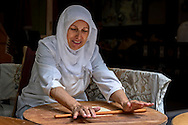 Turkish woman rolling bread