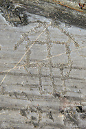 Petroglyph, rock carving, depicting a raised houses built on poles . Carved by the ancient Camunni people in the iron age between 1000-1600 BC. Rock no 24,  Foppi di Nadro, Riserva Naturale Incisioni Rupestri di Ceto, Cimbergo e Paspardo, Capo di Ponti, Valcamonica (Val Camonica), Lombardy plain, Italy .<br /> <br /> Visit our PREHISTORY PHOTO COLLECTIONS for more   photos  to download or buy as prints https://funkystock.photoshelter.com/gallery-collection/Prehistoric-Neolithic-Sites-Art-Artefacts-Pictures-Photos/C0000tfxw63zrUT4<br /> If you prefer to buy from our ALAMY PHOTO LIBRARY  Collection visit : https://www.alamy.com/portfolio/paul-williams-funkystock/valcamonica-rock-art.html
