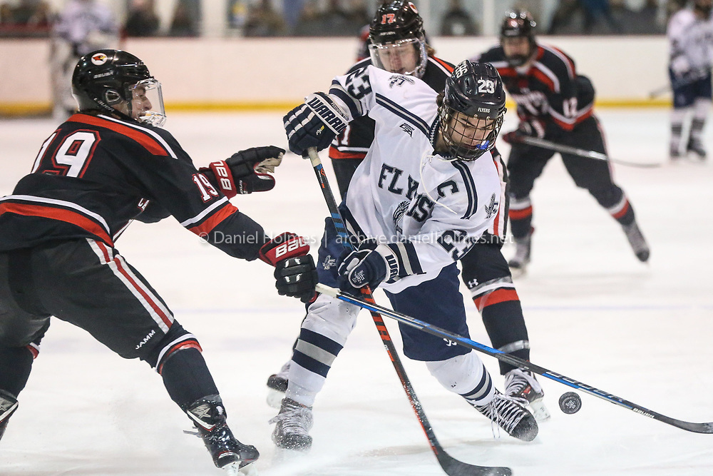 (1/8/19, FRAMINGHAM, MA) Framingham's Michael Tersoni takes the puck to the net during the hockey game against Pope Francis at Loring Arena in Framingham on Tuesday. [Daily News and Wicked Local Photo/Dan Holmes]