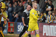 Paul Cook, the Portsmouth manager screams at Goalkeeper Aaron McCarey of Portsmouth as they walk off after the half time whistle. Skybet football league two match, Cambridge Utd v Portsmouth at the Abbey Stadium  in Cambridge on Saturday 10th October 2015.<br /> pic by John Patrick Fletcher, Andrew Orchard sports photography.