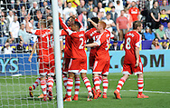 Southampton players celebrate Rickie Lambert's late second half goal.<br /> Barclays Premier league match, Swansea city v Southampton at the Liberty stadium in Swansea, South Wales on Saturday 3rd May 2014.<br /> pic by Phil Rees, Andrew Orchard sports photography.