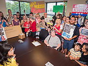 02 JULY 2019 - DES MOINES, IOWA: People wait to meet with someone from Rep. Cindy Axne's office during a protest. About 150 people came to Congresswoman Axne's office in Des Moines Tuesday to protest the treatment of migrant children detained by the US Border Patrol along the US/Mexico border. Axne was not in the office, but a member of Axne's staff took notes and promised to pass people's concerns on to the Congresswoman. Similar protests were held at other congressional offices and Immigration and Customs Enforcement (ICE) detention facilities across the country.          PHOTO BY JACK KURTZ