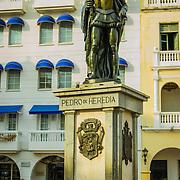 Pedro de Heredia, founder of Cartagena, still stands watch over the Plaza de los Coches, Old City, Cuidad Vieja, Cartagena, Colombia.