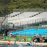 TOKYO, JAPAN  July/August: Photo Essay by Tim Clayton<br /> <br /> Canoe Sprint Finals. Sea Forest Waterway. 12/16<br /> <br /> If the athletes are the heart of any sporting event, the soul are the spectators.Sadly, due to covid 19 restrictions spectators were banned from viewing live what has now become 'the greatest sporting show on earth' The Olympic Games. The cavernous stadiums, many of exceptional quality were left to the whispers of Olympic triumphs past, spirits and history breezing through the empty stands in an attempt to muster up a trace of emotion. The athletes performed, it was no dress rehearsal, but a calling from within to follow that Olympic spirit of faster, higher, stronger and challenge themselves on the ultimate world stage, without the support of their soul mate, the fan.The Olympic Games Tokyo 2020 were like no other… Tokyo, Japan. July August 2021 (Photo by Tim Clayton/Corbis via Getty Images)