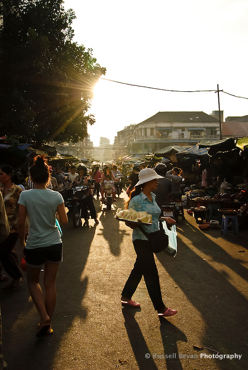 A busy street market in the late afternoon light in Phnom Penh, Cambodia