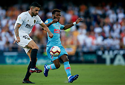 August 20, 2018 - Valencia, Valencia, Spain - Thomas Lemar of Atletico de Madrid competes for the ball with Cristiano Piccini of Valencia CF during the La Liga match between Valencia CF and Club Atletico de Madrid at Mestalla on August 20, 2018 in Valencia, Spain  (Credit Image: © David Aliaga/NurPhoto via ZUMA Press)