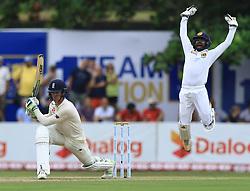 November 6, 2018 - Galle, Sri Lanka - England cricketer Keaton Jennings (L) looks on as Sri Lankan wicket keeper Niroshan Dickwella leaps in the air to appeal during the  1st day's play  of the first test cricket match between Sri Lanka and England at Galle International cricket stadium, Galle, Sri Lanka on November 6, 2018. (Credit Image: © Tharaka Basnayaka/NurPhoto via ZUMA Press)
