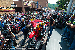 The winner of the Legends Ride annual auction bike checks the bike out in Deadwood, SD during the Sturgis Black Hills Motorcycle Rally. SD, USA. August 4, 2014.  Photography ©2014 Michael Lichter.