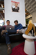 Victor Ng and Zach Heineman work together on a couch at the Pinterest office in San Francisco on Wednesday October 24, 2012. Pinterest is a content sharing service that allows users to pin images on their virtual pin-board. (Photo by Jakub Mosur/For Boston Globe)