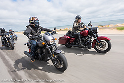 """Custom bike builder Jesse Rooke on a new 2017 Harley-Davidson 750 Street Rod alongside Iron Lilly Leticia Cline testing the all new 2017 Harley-Davidson Road King Special with its 107"""" Milwaukee-Eight engine north on A1A near Flagler Beach during Daytona Beach Bike Week. FL. USA. Tuesday, March 14, 2017. Photography ©2017 Michael Lichter."""