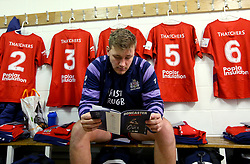 Joe Batley of Bristol Rugby reads the programme on arrival to Castle Park for the B&I fixture with Doncaster Knights - Mandatory by-line: Robbie Stephenson/JMP - 13/01/2018 - RUGBY - Castle Park - Doncaster, England - Doncaster Knights v Bristol Rugby - B&I Cup