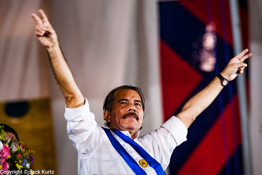 """10 JANUARY 2007 - MANAGUA, NICARAGUA:  DANIEL ORTEGA, newly inaugurated president of Nicaragua, waves to the crowd during his inaugural speech. Ortega, the leader of the Sandanista Front, was sworn in as the President of Nicaragua Wednesday. Ortega and the Sandanistas ruled Nicaragua from their victory of """"Tacho"""" Somoza in 1979 until their defeat by Violetta Chamorro in the 1990 election.  Photo by Jack Kurtz"""