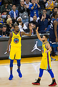 The Golden State Warriors celebrate a basket against the Minnesota Timberwolves at Oracle Arena in Oakland, Calif., on January 25, 2018. (Stan Olszewski/Special to S.F. Examiner)