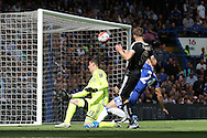 Jamie Vardy of Leicester City takes a shot at goal but sees it saved by Chelsea goalkeeper Thibaut Courtois . Barclays Premier league match, Chelsea v Leicester city at Stamford Bridge in London on Sunday 15th May 2016.<br /> pic by John Patrick Fletcher, Andrew Orchard sports photography.