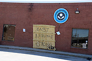 A sign that says East Nashville Strong leans against a business destroyed from the tornados that tore through Nashville, TN on Tuesday March, 3 2020