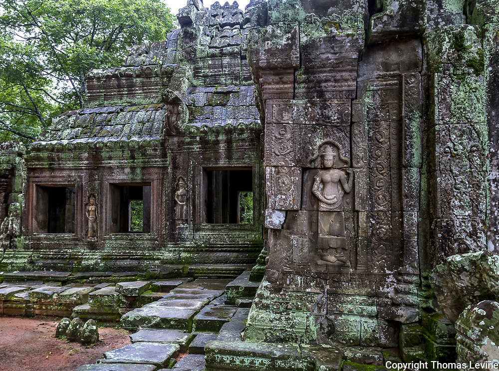 Great angle showing temple Kdei buildings with stone art.