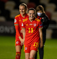 NEWPORT, WALES - Thursday, October 22, 2020: Wales' goal-scorer Lily Woodham (R) celebrates with team-mate Josie Green (L) after the UEFA Women's Euro 2022 England Qualifying Round Group C match between Wales Women and Faroe Islands Women at Rodney Parade. Wales won 4-0. (Pic by David Rawcliffe/Propaganda)