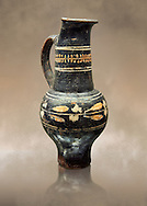 Early 3rd century B.C oenochoe, wine jug, with a trilobata spout, black and overpainted , inv 4380,   National Archaeological Museum Florence, Italy .<br /> <br /> If you prefer to buy from our ALAMY PHOTO LIBRARY  Collection visit : https://www.alamy.com/portfolio/paul-williams-funkystock - Scroll down and type - Etruscan Florence - into LOWER search box. (TIP - Refine search by adding a background colour as well).<br /> <br /> Visit our ETRUSCAN PHOTO COLLECTIONS for more photos to download or buy as wall art prints https://funkystock.photoshelter.com/gallery-collection/Pictures-Images-of-Etruscan-Historic-Sites-Art-Artefacts-Antiquities/C0000GgxRXWVMLyc