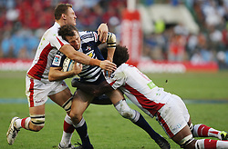 Peter Grant of the Stormers is tackled by Radike Samo and Scott Higginbotham of the Reds during the Super Rugby (Super 15) fixture between DHL Stormers and the Reds played at DHL Newlands in Cape Town, South Africa on 9 April 2011. Photo by Jacques Rossouw/SPORTZPICS