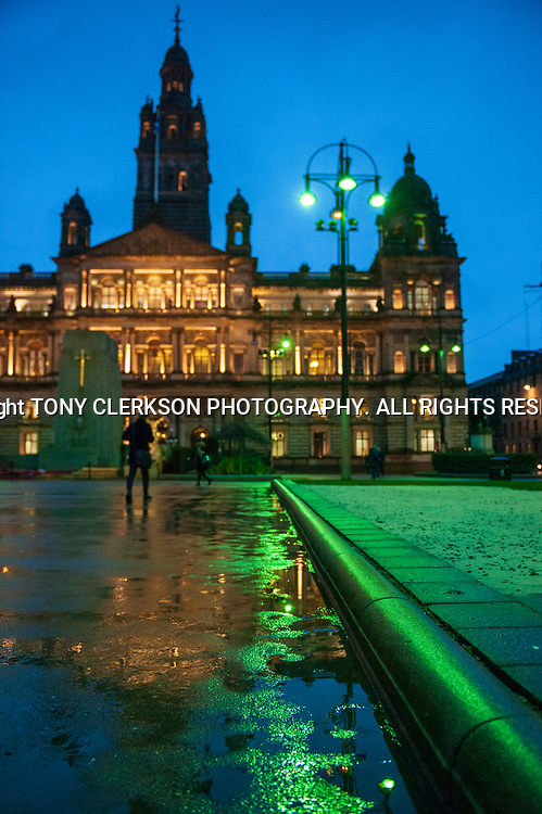 Glasgow City Chambers and George Square briefly illuminated will green glow lights are switched on
