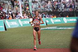 10062018 (Durban) A 4th position Tanith Maxwell, RSA (6:20:35) run towards the finnish line during the 2018 Comrades marathon in Durban.<br /> Picture: Motshwari Mofokeng/ANA