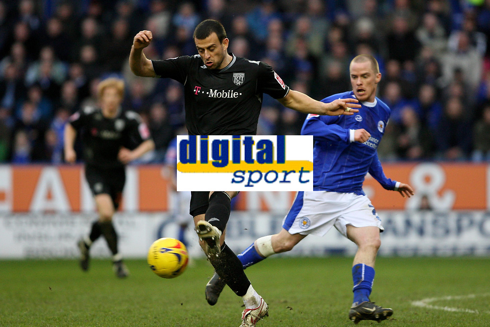 Photo: Pete Lorence.<br />Leicester City v West Bromwich Albion. Coca Cola Championship. 24/02/2007.<br />Neil Clement clears the ball from Iain Hume.