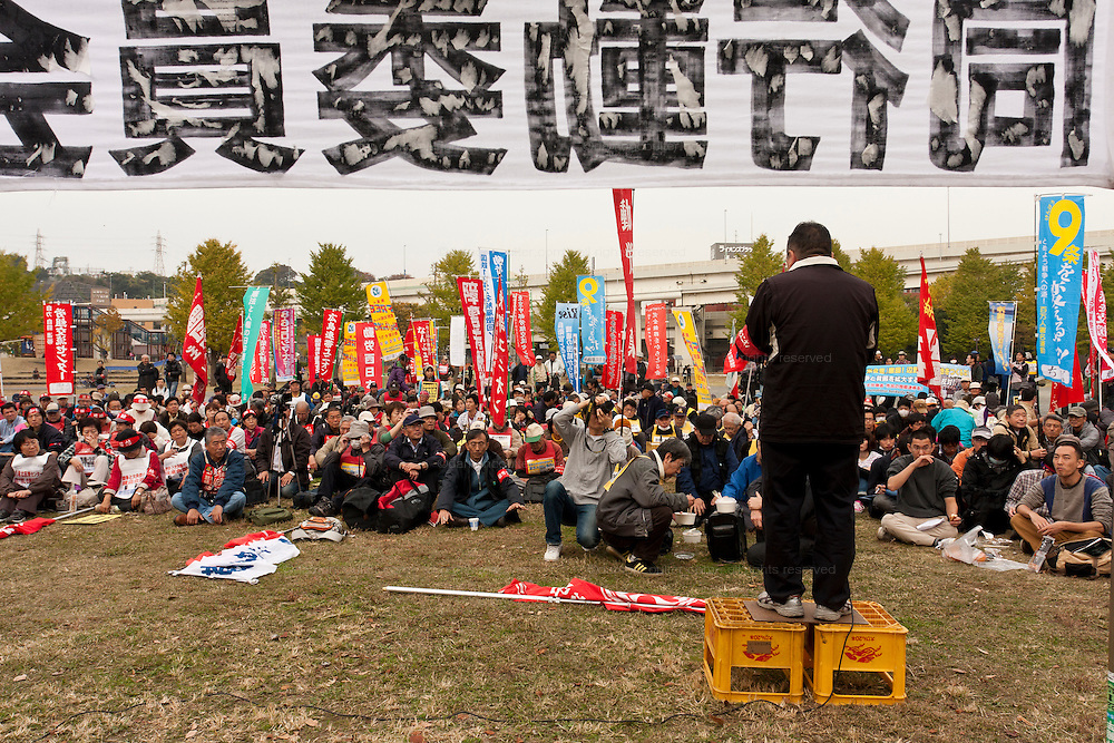 An activist stands on beer crates to address the rally at an Anti APEC (Asia Pacific Economic Conference)  Demo by left-wing activist groups and trade unions in Yokohama, Japan Sunday, November 14th 2010