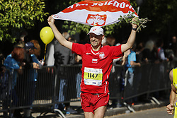 November 13, 2016 - Athens, Attica, Greece - A runner carries a Polish flag. Thousands of people from all over the world took part in the 2016 Athens Marathon the Authentic, which starts in the town of Marathon and is ending in Athens, the route, which according to legend was first run by the Greek messenger Pheidippides in 490 BC. (Credit Image: © Michael Debets/Pacific Press via ZUMA Wire)