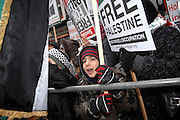 London 04/01/09: Protests outside the Israeli Embassy in London UK: A young boy holds a banner calling for freedom