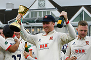 Simon Harmer of Essex celebrates with the County Championship trophy during the Specsavers County Champ Div 1 match between Somerset County Cricket Club and Essex County Cricket Club at the Cooper Associates County Ground, Taunton, United Kingdom on 26 September 2019.