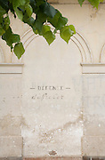 weathered wall with in classical letters Defence d?afficher