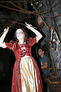 Actress during a play about medieval torture in one of the room inside the London Dungeon, England, on Thursday, Oct. 12, 2006. The London Dungeon is a live theatre attraction where visitors are taken by the actors through different areas featuring the darkest parts of British history. Some of the more than 40 exhibits include 'The Great Fire of London', 'Jack the Ripper', 'Judgement Day', 'The Torture Chamber', 'Henry VIII', 'The Tower of London' and 'The French Revolution'. In 2003 a new part opened focused on the Great Plague of 1665.   **Italy Out**..