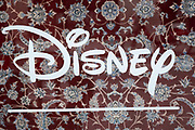 Sign for the media brand Disney Store in the window of a high end oriental rug dealer on 5th March 2021 in London, England, United Kingdom. The Walt Disney Company, commonly known as Walt Disney or simply Disney, is an American diversified multinational mass media and entertainment conglomerate.