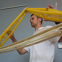 Competitor prepares his construction for the testing at the Spaghetti Bridge World Championship in Budapest, Hungary on May 24, 2013. ATTILA VOLGYI