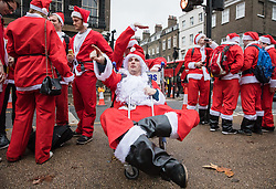© Licensed to London News Pictures. 10/12/2016. London, UK. Thousands of Santas descend on central London for the annual Santacon Parade. Photo credit: Rob Pinney/LNP