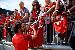 ANN ARBOR, USA - Friday, July 27, 2018: Liverpool's Mohamed Salah signs autographs for supporter after a training session ahead of the preseason International Champions Cup match between Manchester United FC and Liverpool FC at the Michigan Stadium. (Pic by David Rawcliffe/Propaganda)