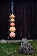 Fishing buoys hanging on wall belonging to Bacca, a self-catering cottage at Gribun, Isle of Mull, Scotland. (http://www.mull.zynet.co.uk/bacca/#cottage)