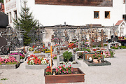 Cemetery in the church grounds, Zell am Ziller, Tyrol, Austria