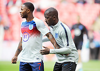 Football - 2018 / 2019 UEFA European Championships Qualifier - Group A: England vs. Bulgaria<br /> <br /> Chris Powell - new addition to England's backroom staff,with Raheem Sterling at Wembley Stadium.<br /> <br /> COLORSPORT/ANDREW COWIE
