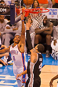 June 2, 2012; Oklahoma City, OK, USA; Oklahoma City Thunder guard Russell Westbrok (0) takes a shot against San Antonio Spurs guard Danny Green (4) during a playoff game  at Chesapeake Energy Arena.  Thunder defeated the Spurs 109-103 Mandatory Credit: Beth Hall-US PRESSWIRE