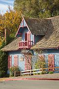 View of old-fashioned colorful house which is historical monument - Antigua sede Oficina de Tierras y Colonias, Oficinas SENASA in Bariloche, Argentina
