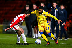 Alex Jakubiak of Bristol Rovers takes on Matty Blair of Doncaster Rovers - Mandatory by-line: Robbie Stephenson/JMP - 26/03/2019 - FOOTBALL - Keepmoat Stadium - Doncaster, England - Doncaster Rovers v Bristol Rovers - Sky Bet League One