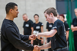 Another P1 student receives his certificate from Franklyn Hartkamp at the Institute Of Krav Maga Scotland grading today at Stirling.<br /> ©Michael Schofield.