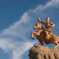 A statue of Damdiny Sukhbataar, the hero of Mongolia's independence from China, towers above Sukhbataar Square in front of the parliament building in Ulaanbaatar.