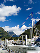 View of the harbor and boats at Milford Sound tour boat docks.