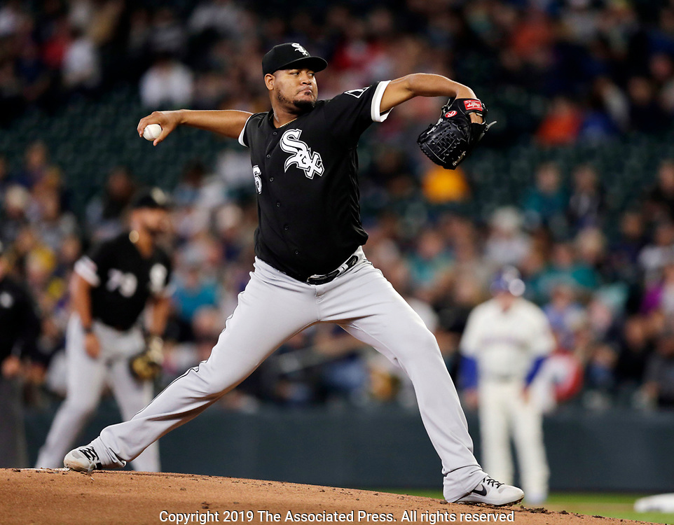 Chicago White Sox starting pitcher Ivan Nova works against the Seattle Mariners during the first inning of a baseball game, Sunday, Sept. 15, 2019, in Seattle. (AP Photo/John Froschauer)