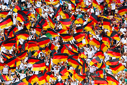 Germany fans wave flags in the stands ahead of the match