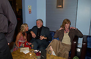 Charlotte Payne, Jeff Lloyd and Michelle Sturgeon. Krug at Tides Bar and Grill. St. David's `Hotel and Spa. Carfiff Bay. 14 April 2005. ONE TIME USE ONLY - DO NOT ARCHIVE  © Copyright Photograph by Dafydd Jones 66 Stockwell Park Rd. London SW9 0DA Tel 020 7733 0108 www.dafjones.com